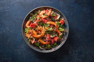 Prawn, Quinoa, Watermelon & Mint Salad on grey plate